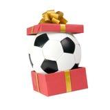 Bille de football dans un cadre de cadeau Images libres de droits