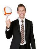 Bille de football de rotation d'homme d'affaires photos stock