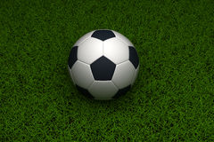 Bille de football sur l'herbe Photos libres de droits