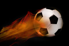 Bille de football sur l'incendie Photo stock