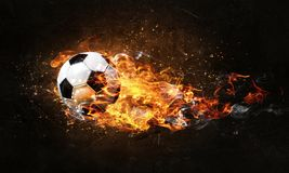 Bille de football sur l'incendie illustration libre de droits