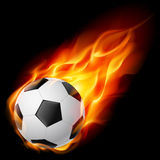 Bille de football sur l'incendie Photographie stock
