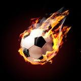 Bille de football sur l'incendie photo stock