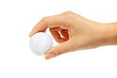 Bille de golf femelle de fixation de main Images stock