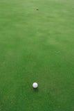 Bille et trou de golf Photographie stock