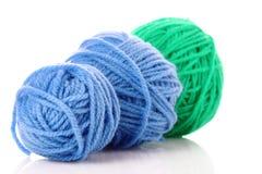 Billes bleues d'amorçage de laine d'isolement Image stock