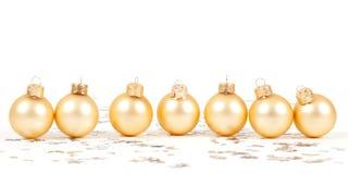 Billes d'or de Noël images libres de droits