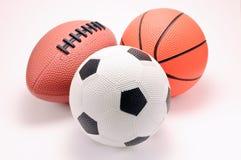 Billes de basket-ball, de football et de football de jouet photographie stock