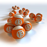 Billes de billard oranges avec le numéro 13 image stock