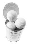 Billes de golf dans la boîte en fer blanc Photo libre de droits