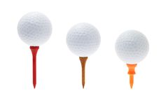 Billes de golf sur des tés images stock