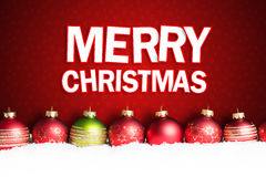 Billes de Noël dans la neige Image stock