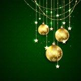 Billes de Noël sur le fond vert Photographie stock libre de droits