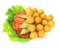 Billes de pomme de terre avec des légumes   Images stock