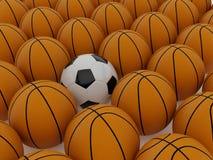 Billes du football et de basket-ball Images stock