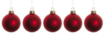 Billes rouges de Noël d'isolement sur le blanc Images libres de droits