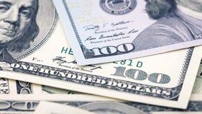 Billet d'un dollar américain d'argent de plan rapproché Beaucoup billet de banque des USA de 100 photographie stock