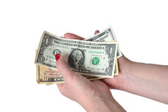 Billet d'un dollar dans la main femelle Photo libre de droits
