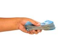 Billet de banque de Handand Photos libres de droits