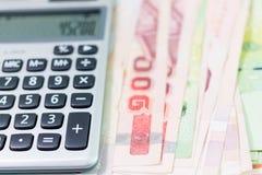Billet de banque et calculatrice Photographie stock