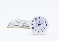 Billet de banque et horloge du dollar Photo stock