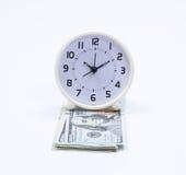 Billet de banque et horloge du dollar Photographie stock libre de droits