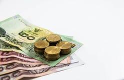 Billet de banque et pièce de monnaie thaïlandais Image stock