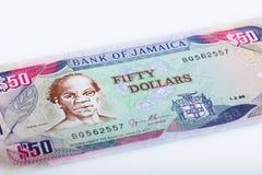 Billet de banque jamaïcain des 50 dollars, fond blanc Photographie stock libre de droits