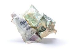 Billet de banque thaïlandais chiffonné sur le blanc Photographie stock libre de droits
