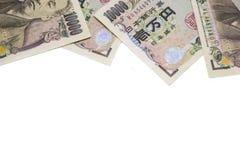 Billet de banque de Yens d'argent sur le fond blanc photographie stock