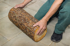 Billet of logs in the hands of a carpenter Stock Photo