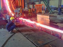 billet steel cutting from continuous casting machine. Stock Image