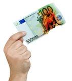 Billete de banco ardiente del euro de las llamas 100 de la mano aislado Imágenes de archivo libres de regalías