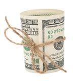 Billete de banco cientos dólares, atados con una cuerda con un arco Fotografía de archivo libre de regalías
