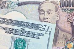 Billete de banco de la moneda y del dólar de los yenes japoneses Fotos de archivo