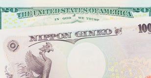 Billete de banco de la moneda y del dólar de los yenes japoneses Imagen de archivo
