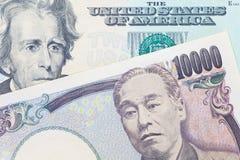 Billete de banco de la moneda y del dólar de los yenes japoneses Foto de archivo libre de regalías