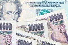 Billete de banco de la moneda y del dólar de los yenes japoneses Fotografía de archivo