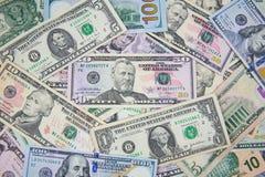 Billete de banco del dólar separado en la tierra Imagenes de archivo