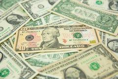 Billete de banco del dólar separado en la tierra Imágenes de archivo libres de regalías