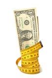 Billete de banco del dólar y cinta de la medida Imágenes de archivo libres de regalías