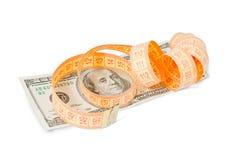 Billete de banco del dólar y cinta de la medida Imagenes de archivo