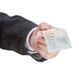 Billete de banco del euro cinco en la mano masculina Fotos de archivo libres de regalías