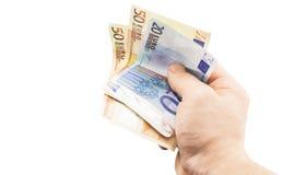 Billete de banco en la denominación del euro 50 y 20 a disposición Foto de archivo libre de regalías