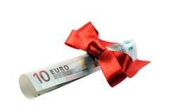 Billete de banco euro como regalo de la Navidad foto de archivo