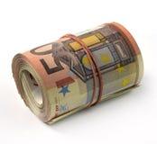 Billete de banco euro doblado en un rollo Imagen de archivo libre de regalías