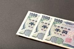 Billete de banco japonés tres 1000 yenes Imágenes de archivo libres de regalías