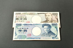 Billete de banco japonés 10000 yenes y 1000 yenes Imagen de archivo libre de regalías