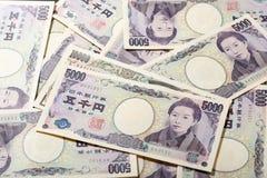 Billete de banco japonés 10000 yenes y 5000 yenes Fotos de archivo libres de regalías