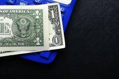 Billete de banco y calculadora Fotografía de archivo